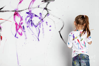 Photograph - Little Girl Painting A White Wall With Colorful Paint. by Michal Bednarek