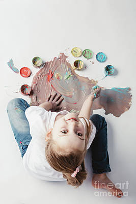 Photograph - Little Girl Painting With Her Hands On The Floor. by Michal Bednarek