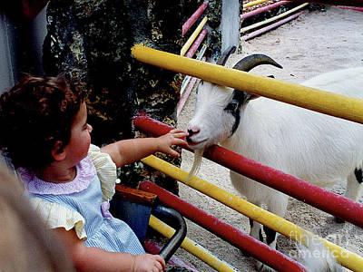 Photograph - Little Girl Petting Friendly Goat by Merton Allen