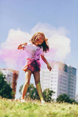 Photograph - Little Girl Playing In Colorful Clouds Of Holi Powder by Michal Bednarek