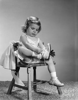 Little Girl Putting On Shoes, C.1960s Art Print