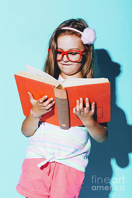 Photograph - Little Girl Reading A Book, Wearing Funny Red Glasses. by Michal Bednarek
