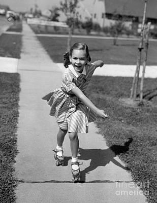 Little Girl Roller-skating On Sidewalk Art Print by Debrocke/ClassicStock