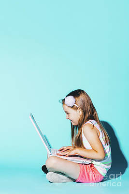 Photograph - Little Girl Sitting With Laptop On Her Knees, Looking At The Screen. by Michal Bednarek