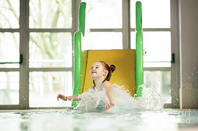 Photograph - Little Girl Sliding Down The Water Slide by Michal Bednarek