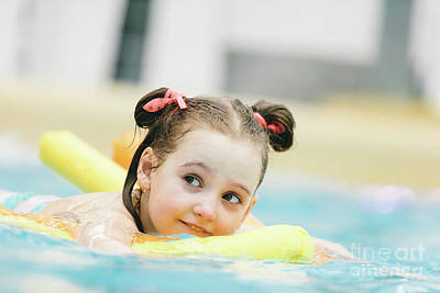Photograph - Little Girl Swimming With A Yellow Noodle In A Pool. by Michal Bednarek