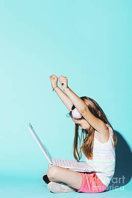 Photograph - Little Girl With Laptop On Her Knees, Raising Her Hands Up by Michal Bednarek
