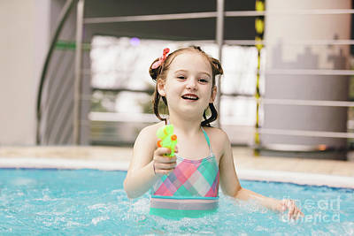 Photograph - Little Girl With Water Pistol In A Swimming Pool. by Michal Bednarek