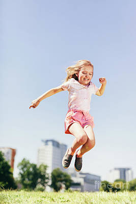 Photograph - Little Happy Girl Jumping High On The Meadow. by Michal Bednarek