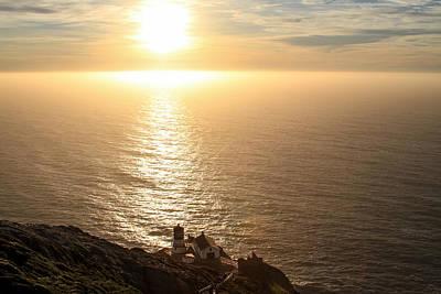 Photograph - Little Lighthouse Big Sunset by Bonnie Follett