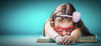 Photograph - Little Tired Girl Laying On An Open Book by Michal Bednarek