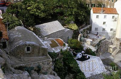 Yugoslavian Photograph - Living On The Cliffside by Morris Keyonzo