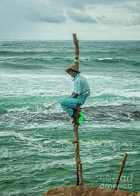 Photograph - Local Fisherman On A Pole by Patricia Hofmeester