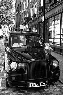 London Taxi Art Print by John Rizzuto