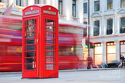 Photograph - London, Uk. Red Telephone Booth And Red Bus Passing by Michal Bednarek