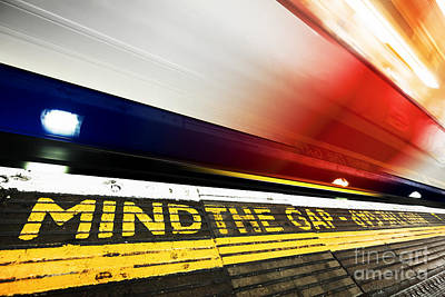 Photograph - London Underground. Mind The Gap Sign, Train In Motion by Michal Bednarek