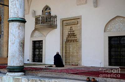 Photograph - Lone Muslim Man Prays Outdoors Near Mihrab At Sarajevo Mosque  Bosnia Hercegovina by Imran Ahmed