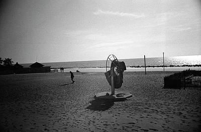 Photograph - Lonely Man In Ostia Beach by Nacho Vega
