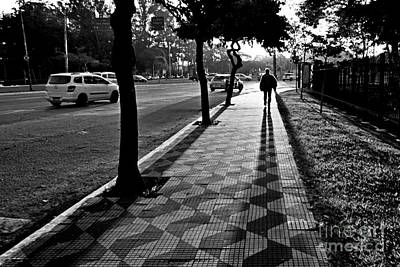 Photograph - Lonely Man Walking At Dusk In Sao Paulo by Carlos Alkmin