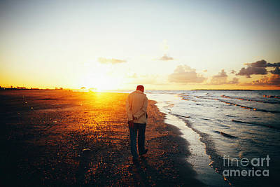 Railroad - Lonely Man Walking On The Beach At Sunset. by Mohamed Elkhamisy