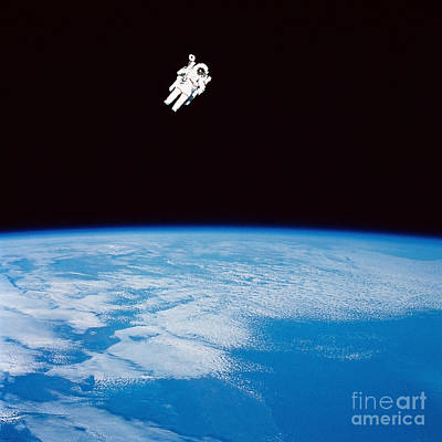 Photograph - Long Shot Of Astronaut In Space by Stocktrek Images