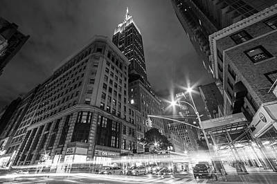 Photograph - Looking Up At The Empire State Building From Fifth Avenue At Night New York Ny Black And White by Toby McGuire
