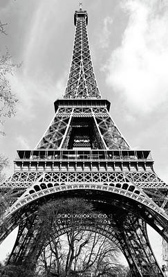 Photograph - Looking Up At The Sunlit Face Of The Eiffel Tower In Paris France Black And White by Shawn O'Brien