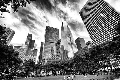 Bryant Photograph - Looking Up In Bryant Park by John Rizzuto