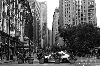 Ny Police Department Photograph - Looking Uptown Mono by John Rizzuto