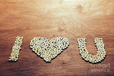 Photograph - Love Symbol Made Out Of Little Wooden Hearts by Michal Bednarek