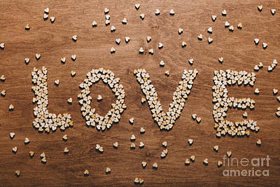Photograph - Love Writing Made Out Of Little Wooden Hearts by Michal Bednarek