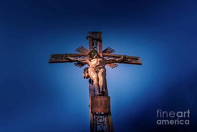 Crucifix Art Photograph - Low Angle View Of Jesus Christ Statue by Bernard Jaubert