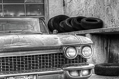 Photograph - Lowell Arizona Old Rusted Car Lowell Movie Theater Black And White Tires by Toby McGuire