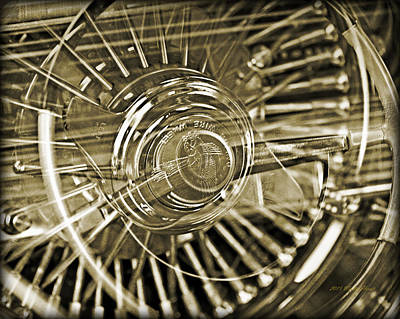 Photograph - Lowrider Wheel Illusions 2 by Walter Herrit