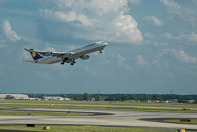 Photograph - Lufthansa Airlines A Departure Too Airbus 340-300 D-aigo Airport Art by Reid Callaway