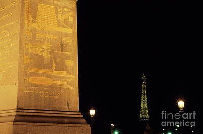 Streetlight Photograph - Luxor Obelisk In The Concorde Plaza With View Of The Eiffel Tower Illuminated At Night by Sami Sarkis