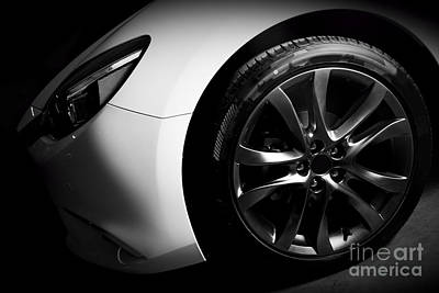 Metallic Photograph - Luxury Sports Car Close Up Of Aluminium Rim And Headlight by Michal Bednarek