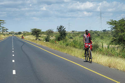 Photograph - Maasai On Bike With Cell Phone by Mary Lee Dereske