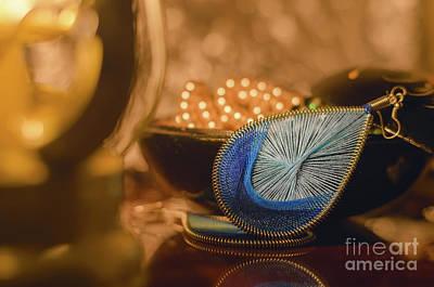 Earring Set Photograph - Macro Various Blue Earring Imitation Jewellery. Orange Light, Warm Toned. Blur Background. Lantern by Y K