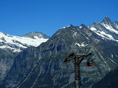 Photograph - Maennlichen Gondola Calbleway, In The Background Mettenberg And Schreckhorn by Ernst Dittmar