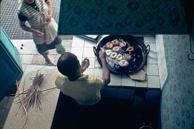 Photograph - Making Donuts - Egypt by John Battaglino