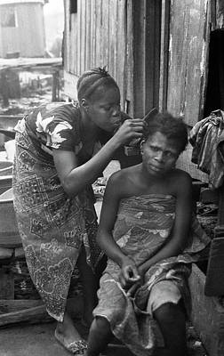 Photograph - Helping Hand For Plaiting by Muyiwa OSIFUYE