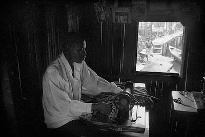 Photograph - A Tailor At Work by Muyiwa OSIFUYE
