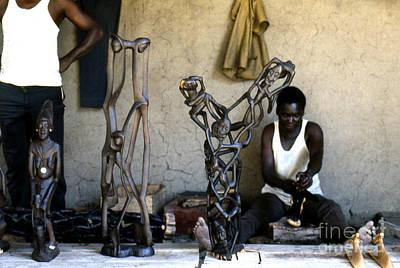 Artist Working Photograph - Makonde Wood Carver by Erik Falkensteen