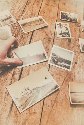 Male Hand Holding Instant Photo On Wooden Table Print by Jorgo Photography - Wall Art Gallery