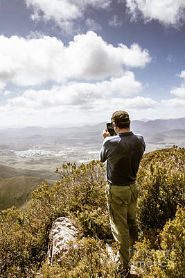 Male Tourist Taking Photo On Mountain Top Art Print