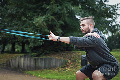 Photograph - Man And His Sport Routine. City Park. by Michal Bednarek