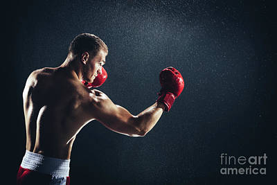 Photograph - Man Boxing With Red Gloves On His Hands In The Rain. by Michal Bednarek