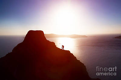 Ambition Photograph - Man Climbing Up Hill To Reach The Peak Of The Mountain Over Ocean by Michal Bednarek