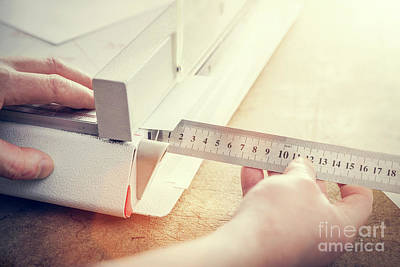 Professional Photograph - Man Does Measuring With Slide Calliper In Paper Cutter by Michal Bednarek
